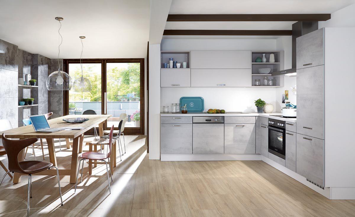 Moderne und minimalistische Betonküche in urbanem Design; Foto: nobilia