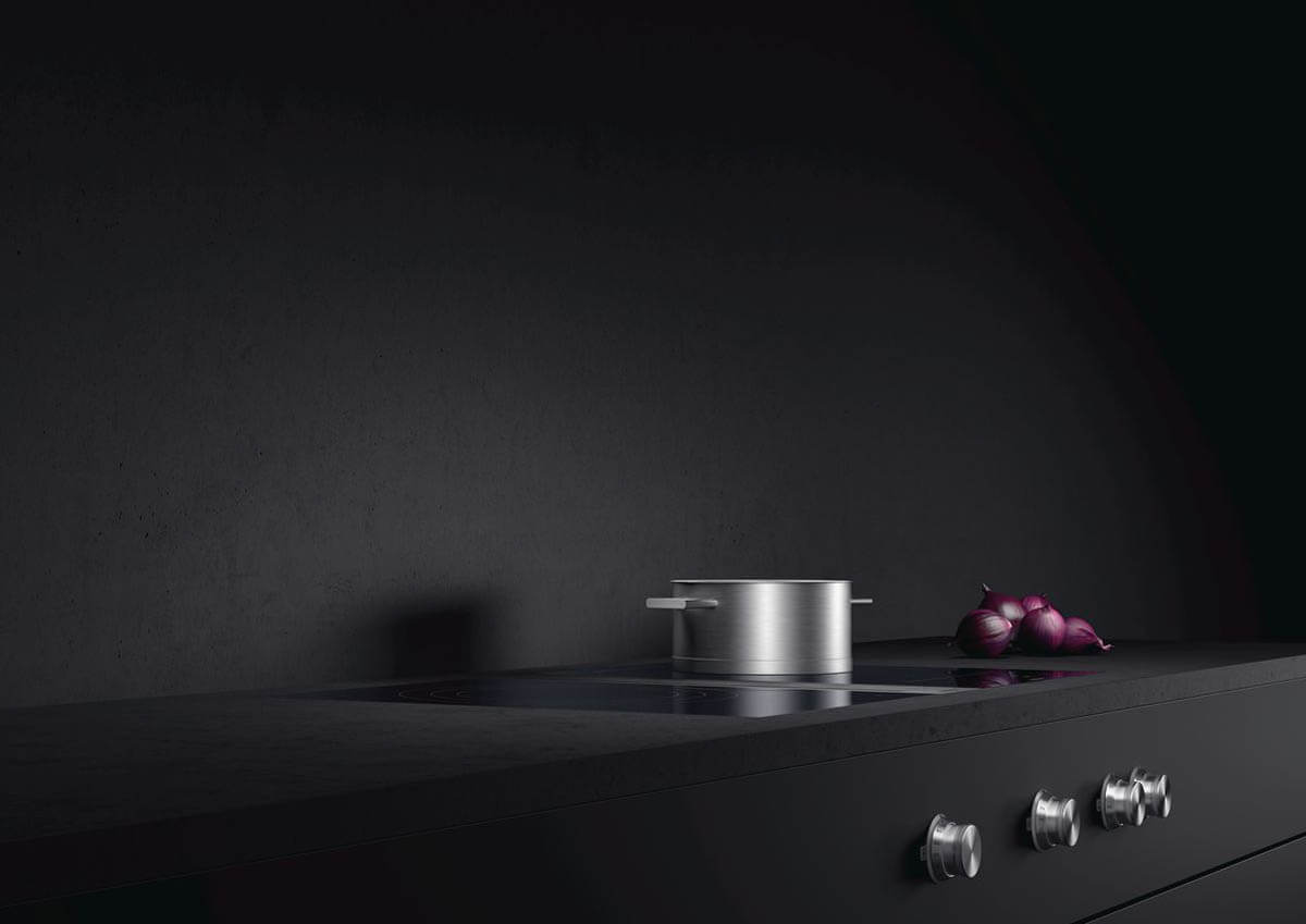 Gaggenau Flex-Induktionskochfeld der Serie 400 mit Downdraft Kochfeldabzug, bei dem die Bedienknöpfe nahtlos in die Arbeitsplatte integriert wurden. Foto: Gaggenau